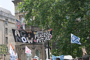 'Act now for a peaceful future' banner. Extinction Rebellion climate change protest march. Bristol, England, UK. 16 July 2019.  -  Ben Gillett