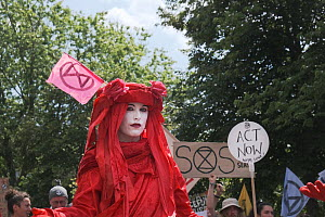 Woman protestor, part of The Red Brigade, at Extinction Rebellion climate change march. Bristol, England, UK. 16 July 2019.  -  Ben Gillett