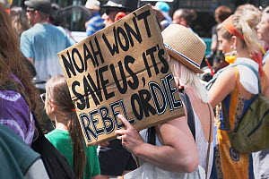 'Noah won't save us, it's rebel or die' placard held by protestor. Extinction Rebellion march and rally, Bristol, England, UK. 16 July 2019.  -  Ben Gillett