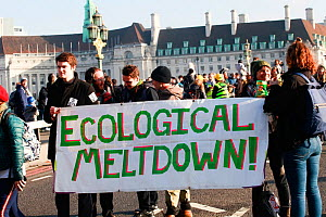 Protestors holding 'Ecological meltdown!' banner at Extinction Rebellion climate change demonstration. London, England, UK. 17 November 2019.  -  David  Woodfall