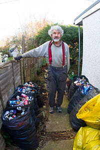 Kevin Whales, man with litter he has picked from street and sorted for recycling. Jaywick, Essex, England, UK. - David  Woodfall