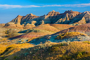 Late afternoon light warms the colors in the Yellow Mounds area, Badlands National Park, South Dakota, USA, September.  -  John Shaw
