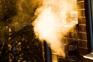 Water vapour and waste gases from gas central heating in house.  -  David  Woodfall