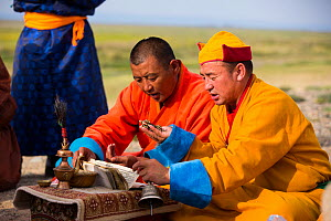 Monks chanting sutras in mountain worshipping ceremony. Great Gobi B Strictly Protected Area, Mongolia. 2018. - Cyril Ruoso
