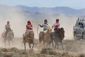 Four boys racing young horses during Naadam festival. Great Gobi B Strictly Protected Area, Mongolia. August 2018. - Cyril Ruoso