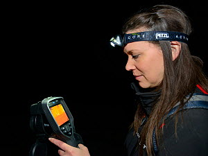 Lucy Bearman-Brown using a thermal imager to find Hedgehogs (Erinaceus europaeus) out foraging after dark, Hartpury University, Gloucestershire, UK, June 2019. Model released. - Nick Upton