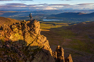 Mountain hiker at sunrise overlooking Coire an t-Sneachda in the Cairngorms National Park, Scotland, UK, July. - SCOTLAND: The Big Picture