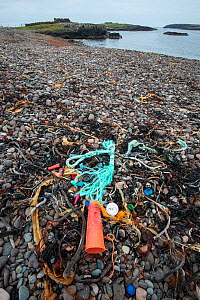Discarded plastic and nylon rubbish on remote shingle beach. Shetland, Scotland, UK. July 2018. - Adrian Davies