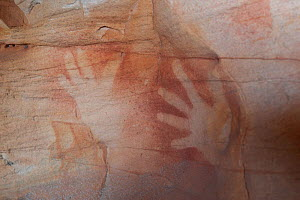Wandjina Aboriginal rock art, depiction of hands of the Wunambal Gaambera / Uunguu people. Wary Bay, Bigge Island, Bonaparte Archipelago, The Kimberley, Western Australia. 2015.  -  Rick Price