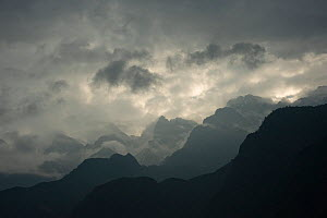 Peaks and clouds above Tiger Leaping Gorge at dawn. Three Parallel Rivers of Yunnan Protected Areas World Heritage Site, Yunnan Province, China. 2010. - Heather Angel