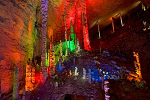 Huanglong / Yellow Dragon Cave stalagmites in colourful lighting. Hunan Province, China. 2010.  -  Heather Angel