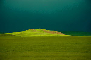 Sunlight on grassland from Qinghai-Tibet / Qingzang railway, the world's highest railway. August 2009. - Heather Angel