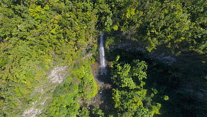 Drone shot flying along a river and revealing the top of Middleham Falls, Morne Trois Pitons National Park, Dominica, 2019. - Derek Galon