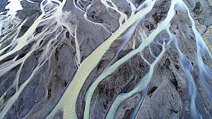 Aerial shot of the Hafursa glacial river running over black sand, southern Iceland, August 2018. - Milan Radisics