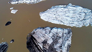 Aerial view of large pieces of calved ice in a meltlake beneath Hoffellsjokull, an outlet glacier of the Vatnajokull ice cap, Iceland, August 2018  -  Milan Radisics