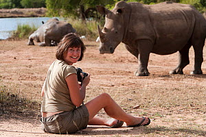 Photographer Ann Toon taking pictures of White rhino (Ceratotherium simum) at Hlane game reserve, Swaziland - Ann  & Steve Toon