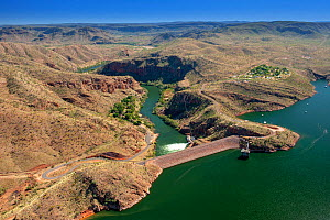 Lake Argyle reservoir dam wall and outflow, aerial view. Reservoir dammed in 1971 for Ord River Irrigation Scheme. The Kimberley, Western Australia. 2017. - Steven David Miller