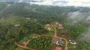 Aerial shot showing area of rainforest destroyed for luxury housing, Santo Domingo Province, Ecuador, 2017. - Morley Read