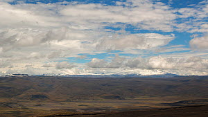 Panning time-lapse along the Eastern Cordillera of the Andes, from the snowcapped peak of Antisana Volcano to Sincholagua Volcano, seen from the slopes of Cotopaxi Volcano, 2018.  -  Morley Read