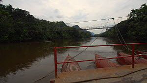 Timelapse of a cable ferry crossing the Nangaritza River, seen from the deck of the ferry, Zamora Chinchipe Province, Ecuador, 2018. - Morley Read