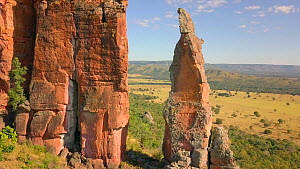 Drone shot passing through rock formation in a cerrado landscape, Matto Grosso, Brazil. - Laurie Hedges