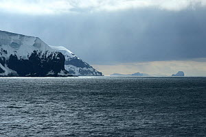 Coastal cliffs topped with snow and ice. East coast of Buckle Island, Balleny Islands, East Antarctica. January 2018.  -  Mike Potts