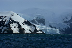 Glacier meeting Southern ocean on coast of Buckle Island, Balleny Islands, East Antarctica. January 2018.  -  Mike Potts