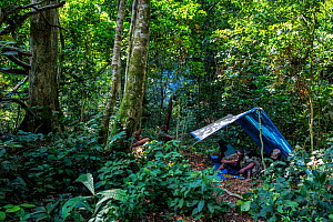 Rangers take a break and set up camp for the night while on patrol in the 8.9 million acres of Salonga National  Park, Democratic Republic of Congo. May 2017.  -  Karine Aigner
