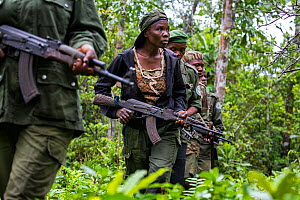 Portrait of female ecoguard / ranger, with colleagues in Salonga National Park, Democratic Republic of Congo. May 2017. There are 16 women who work as Ecoguards protecting the largely untouched 8.9 mi...  -  Karine Aigner