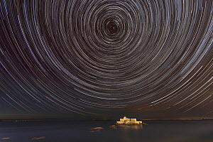 Stars Trails around the North Star, above sea and National Fort, Saint-Malo, Brittany, France.  -  Christophe Courteau
