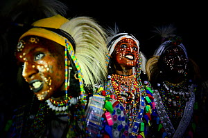 Men from Wodaabe ethnic group dancing with painted faces and in traditional dress. During Gerewol gathering of different clans women choose a husband. Sahel, Africa. 2019. Digital composite.  -  Enrique Lopez-Tapia