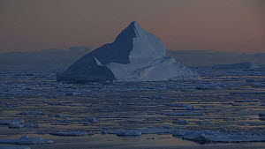 Tracking shot through pack ice, around a pyramid-shaped iceberg, Antarctica, 2018.  -  Fred  Olivier