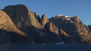 Glacially carved rock formations at sunset, Greenland, 2016.  -  Fred  Olivier