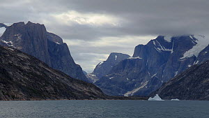 Shot in transit of a glacial valley with high cliffs, Skoldungen Fjord, Greenland, 2016.  -  Fred  Olivier