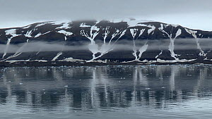 Tracking shot of fjord and reflections, Sabine Land, East Spitsbergen, Svalbard, Norway, 2016.  -  Fred  Olivier