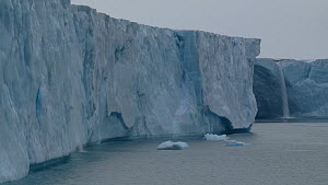 Wide shot of the terminus of Brasvellbreen Glacier, with meltwater waterfall, Svalbard, Norway, 2016.  -  Fred  Olivier