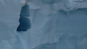 Close-up of a meltwater waterfall emerging from a glacier, Brasvellbreen Glacier, Magdalena Fjord, Svalbard, Norway, 2016. - Fred  Olivier