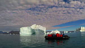 Tourists on a zodiac iceberg cruise, Scoresby Sound, Greenland, 2016.  -  Fred  Olivier