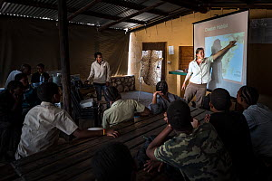 ?Education officer Jane Horgan, from Cheetah Conservation Botswana (CCB), talking to children attending their bush camp in the Kalahari - 30km outside Ghanzi - about where Cheetahs (Acinonyx jubatus)...  -  Doug Gimesy