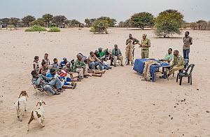 A meeting at a farming co-operative run by members of Cheetah Conservation Botswana (CCB) and the Department of Wildlife and National Parks. A representative of DWNP explaining the differences between...  -  Doug Gimesy