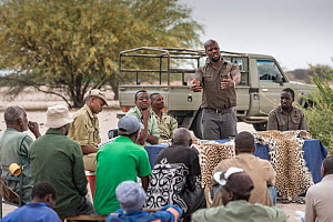 A meeting at a farming co-operative run by members of Cheetah Conservation Botswana (CCB) and the Department of Wildlife and National Parks. Phale Max Seele from CCB is talking to farmers to help supp...  -  Doug Gimesy