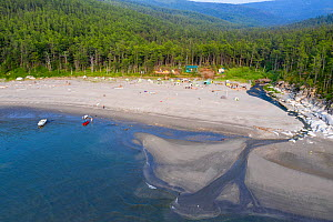 Beach and river estuary, boreal forest in background, aerial view. Camp on beach, gathering to watch Bowhead whale (Balaena mysticetus) congregation. Vrangel Bay, Primorsky Krai, Russia. August 2019.  -  Franco  Banfi
