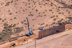 Aerial view of construction of the controversial southern border wall between Arizona and Sonora, Mexico. This is being converted from a ten foot wall to a thirty foot high barrier in accordance with...  -  Jack Dykinga