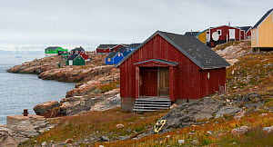 Brightly painted houses of Ittoqqortoormlit village, Scoresby Sund, East Greenland, August, 2019. - John Shaw