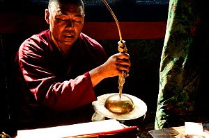 Lama praying in the Shey Monastery, Indus Valley. Ladakh, India. September 2011.  -  Enrique Lopez-Tapia
