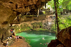 The Zaci cenote with people swimming, in the middle of Valladolid, Yucatan peninsula, Mexico.  -  Pascal Kobeh