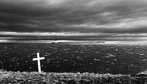 Stormy seas and cross on a grave. In background is the Malmey island. Iceland 2016 - Espen Bergersen
