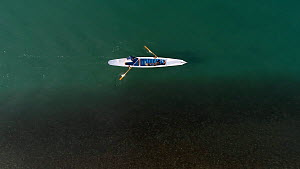 Aerial tracking shot of two gondolier's propelling a gondola in Venice Lagoon, Venice, Italy, October 2015. - Milan Radisics