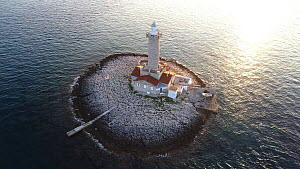 Aerial tracking shot of Porer lighthouse on a small island in the Adriatic Sea, Croatia, 2015.  -  Milan Radisics