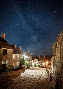 Gold Hill at night, with the Milky Way above, Shaftesbury, Dorset, England, UK, August 2018.  -  Guy Edwardes
